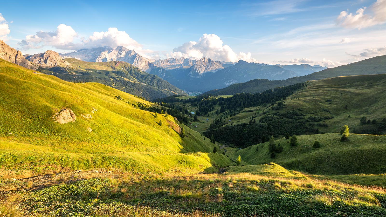 Panorama of Val di Fassa at sunset with the Dolomites in the background