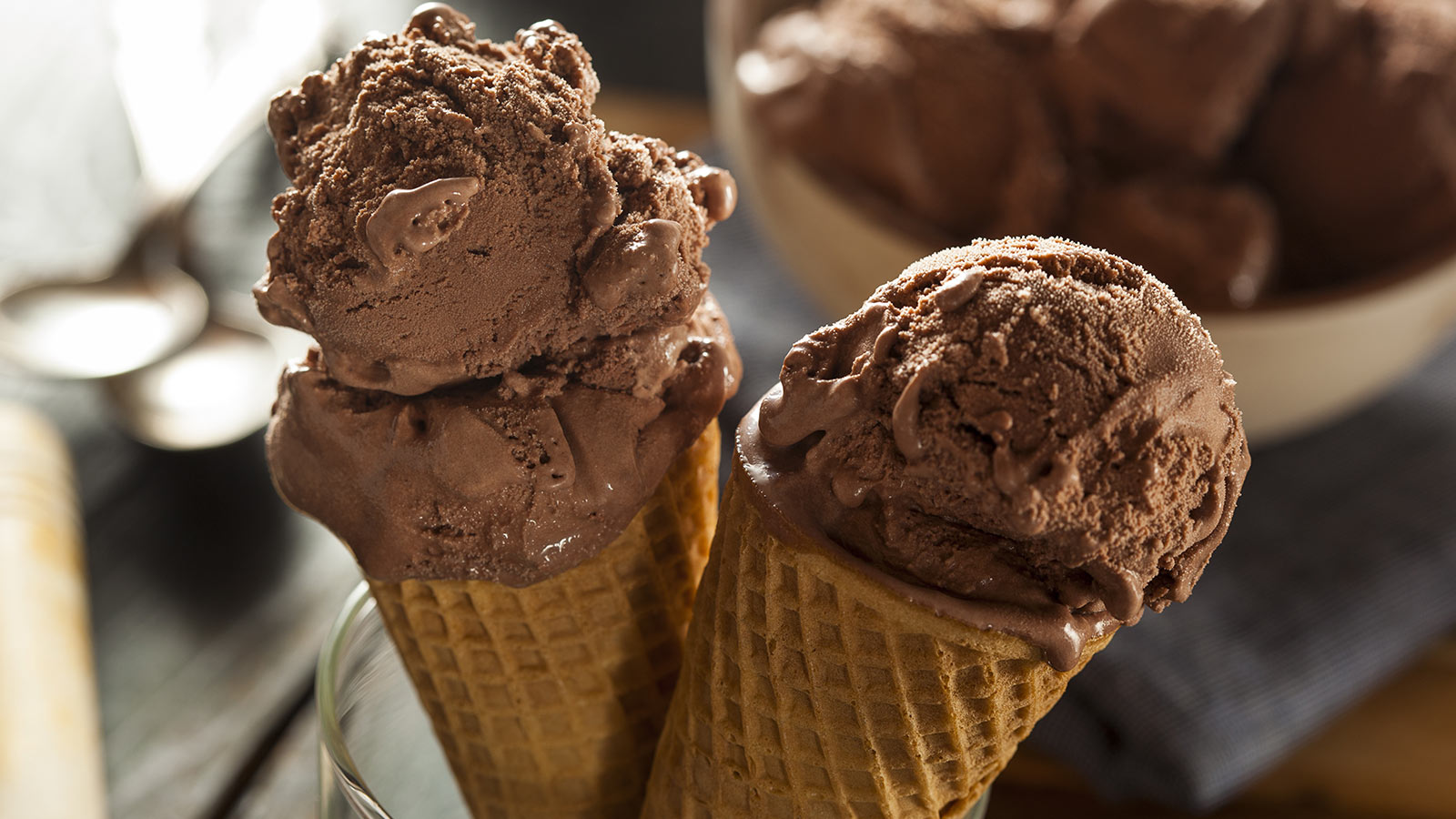 Two large chocolate ice cream cones